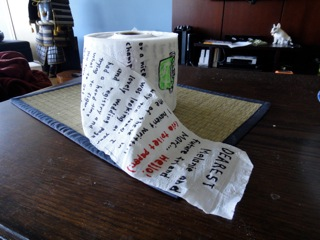 rolled up toilet paper with writing on it