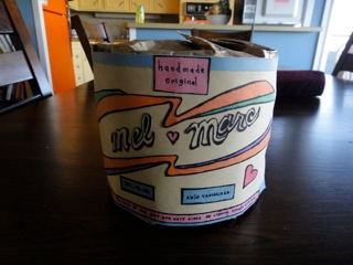 Completed gift - a toilet paper roll with writing covered with original wrapping